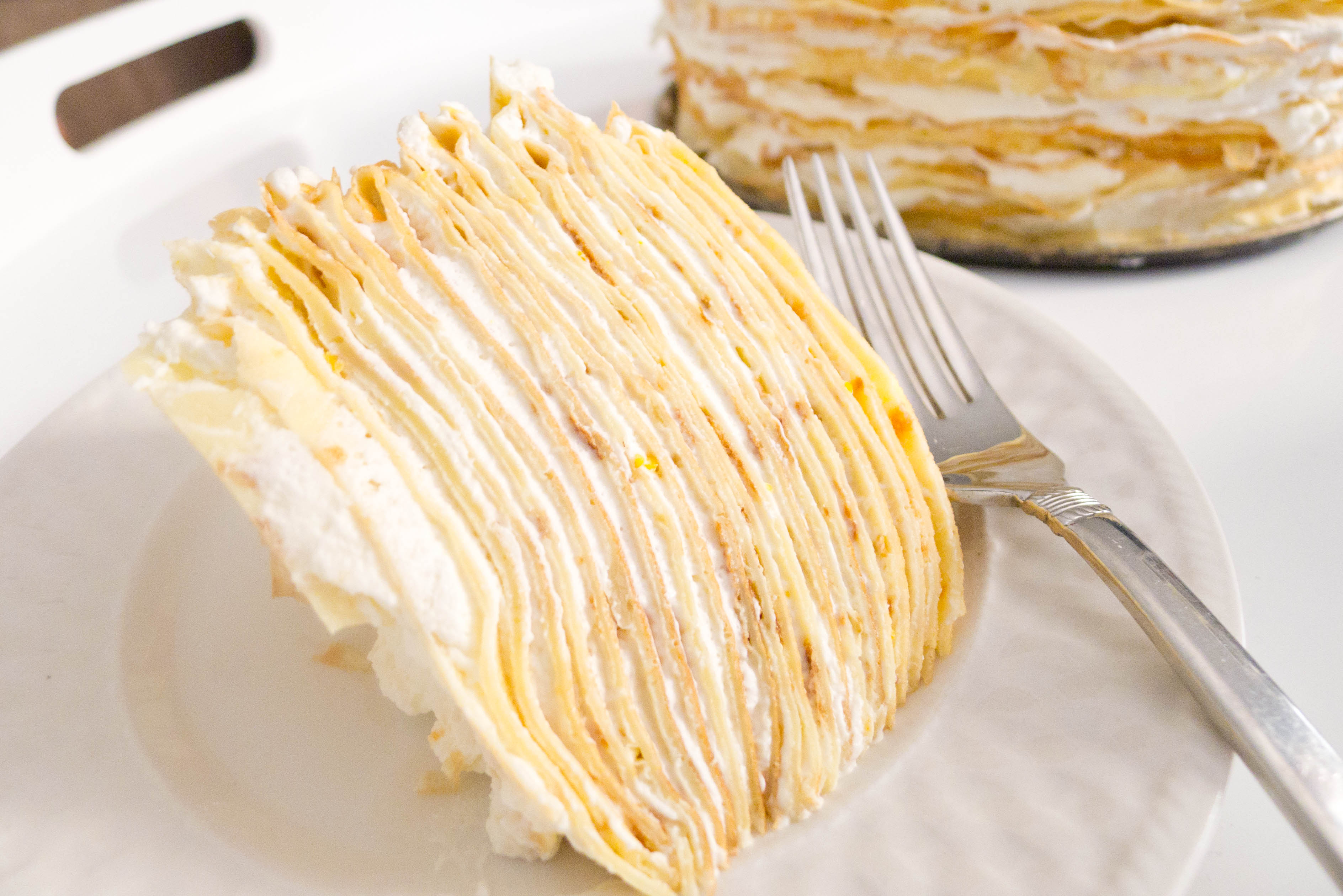 french crêpe cake Thin french crêpes are layered up with vanilla-tainted pastry cream to make an extravagant, elegant cake.